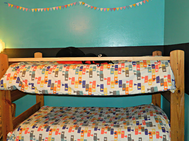 Alexander Girard duvet bunting teal chalkboard wall shared bedroom  Just Peachy, Darling