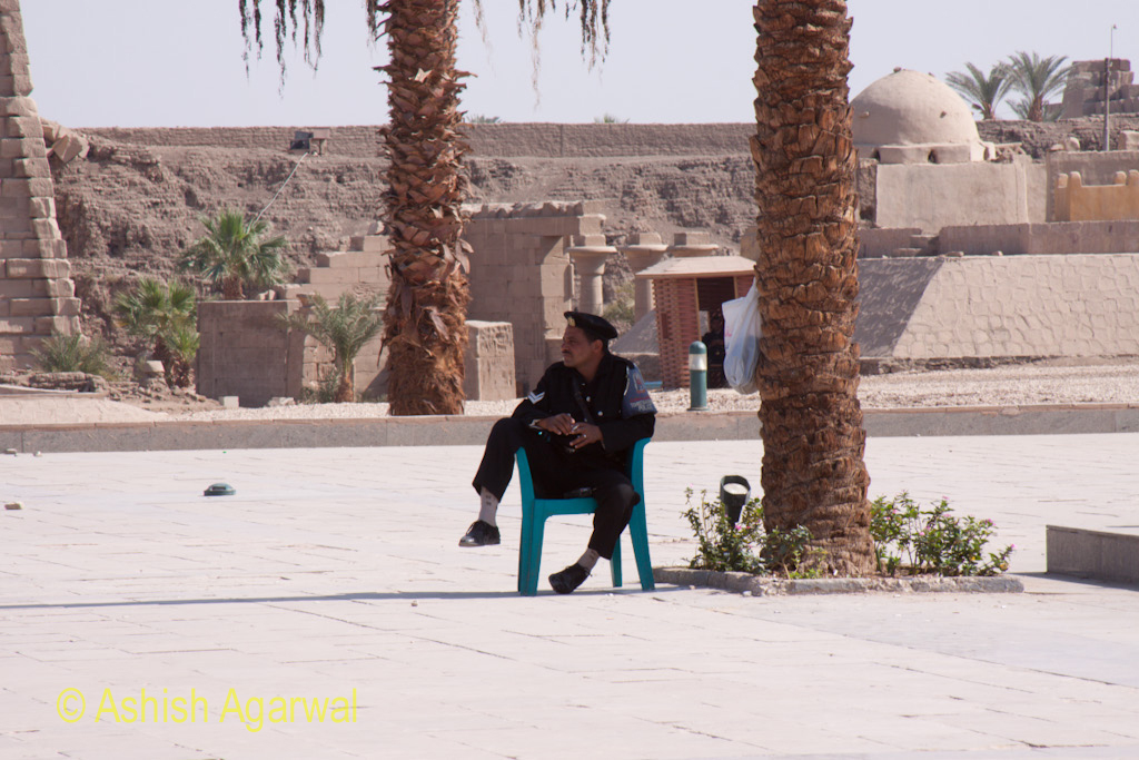 A seemingly bored security guard at the Karnak temple in Luxor
