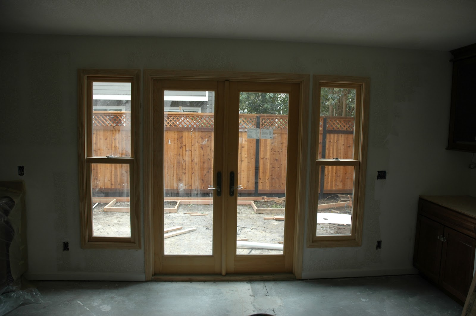 So many options which door do i choose ot glass for Double hung french patio doors