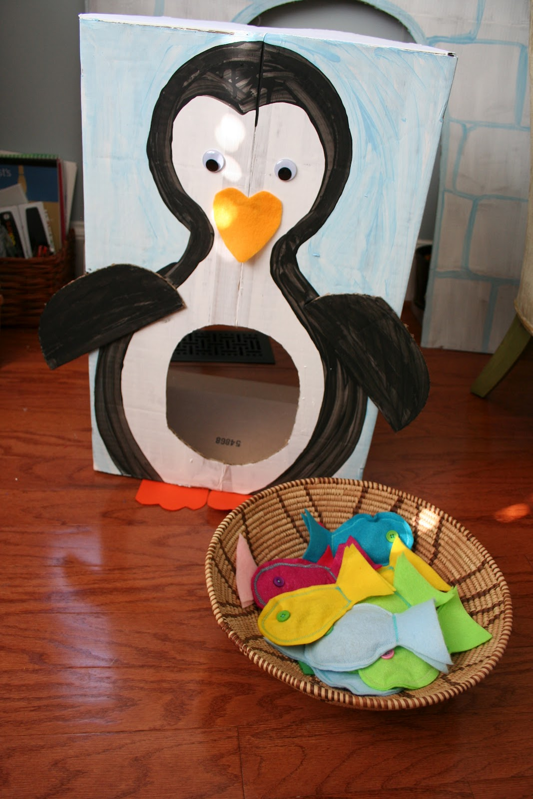 Pink and green mama cardboard penguin toss game and for Game and fish