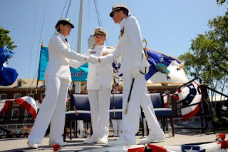 Rear Adm. Sandra Stosz shakes hands with Rear Adm. J. Scott Burhoe following their change of command ceremony at the United States Coast Guard Academy June 3, 2011.