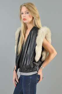 Vintage 1980's black leather vest with cream colored arctic fox fur trim.