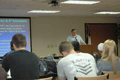 Student with liberty shirt is shown in Dr. Vaughn seminar.