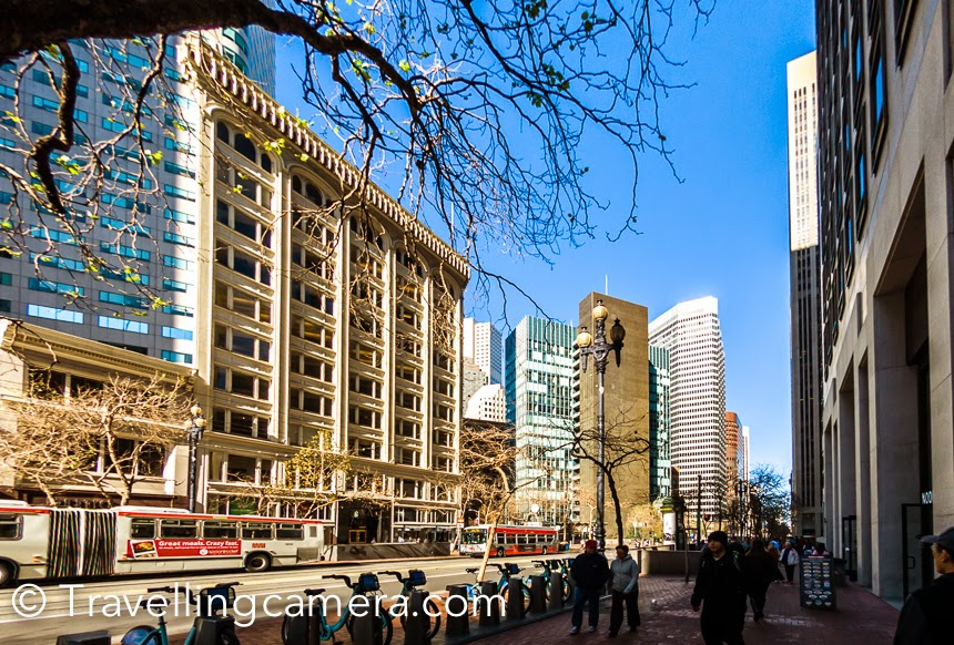 In San Francisco, we were staying in Hilton which is very well located at Union Square. Union Square is well placed  in the city and close of some of popular places like Pier-39, Ferry Building, Fishermen's Warf, China Town, Ghirardelli square, Explotarium, Bay bridge etc. During one of the days, we planned to walked down to Ferry building and then moved across the piers to hit Fishermen's warf. This Photo Journey shares more about this interesting walk and few tips, if you plan to do so.We walked to cable car station of Union Square and from here you can see the Ferry building. We planned to walk down to Ferry building. One can also take Muni or bus which costs $2.25. It was 10-15 minutes walk.This whole walk is through some of the highest buildings in San Francisco city. This street has some interesting restaurants if you are someone who like exploring different types of food. We also noticed a Chai kiosk. We wanted to stop for a sip of chai, but skipped.We hit this beautiful Ferry building at the end of this street. The Ferry building has some interesting shops inside. As we headed towards the building, we came across a group of 20-25 kids doing various stunts on skateboards. We paused for a while, watched them and moved ahead. For a while the famous show 'Science of Stupids' came to my mind :).Just behind the Ferry building, there is a statue of Mahatma Gandhi . There are quite a few benches around this place and folks can be seen reading books or spending peaceful time on bay side. During some specific days, farmer's market is organized at the same space. A ferry starts from Ferry building to Sausalito and we noticed lot of folks taking this ferry. The other day we went towards Sausalito & Sonoma, which are very beautiful neighborhoods overlooking the bay and some parts of San Francisco.  After spending some time on the back side of Ferry building, we went inside and checked some shops. They were selling some interesting stuff. Also this building has some popular restaurants.Now we headed towards Explotarium, which is another interesting place. This is a must go place, especially when kids are accompanying you. We also visited the Explotarium shop, which has some interesting stuff. I bough spy glasses for my nephew. Through these you can see things behind you :). And a submarine which does some action in water when you put soda powder in it's chamber. We headed towards Peir-39, which was full of private and club boats parked across the pier.The famous Aquarium of the Bay is situated on Peir-39 and there is a good market around the same. I didn't go inside the Aquarium as per feedback from other folks. It seems that aquarium is smaller as compared to the one in monterey. Probably I will visit it next time :) Pier-39 is most happening pier in San Francisco. Lot of street shows keep happening along the road in front of Pier-39. There is a place on Pier-39 from where sea lions can be seen.Someone told me that Hard Rock cafe at Pier-39 is the first one, but it's not. There were few performances happening outside Hard Rock cafe. We headed towards the deck from where sea lions can be seen. This part of is usually very crowded although these sea lions are very lazy and there is hardly any action there :).It's just 2 minutes walk from Hard Rock cafe to the place where Sea lions can be seen. These sea lions are usually very lazy, so don't expect any action out there.Sea lions can mostly be seen on these wooden decks floating in water. It was a perfect day in San Francisco to try my favorite star-effect shot :). From this deck, you can enter into the Pier-39 market from where you can buy some souvenirs although I found this market a bit expensive, because same stuff was available in Union Square at relatively cheaper rates. There is another market across the Peir-39 which didn't seem to be a trusted place to buy anything. I asked the cost of Nikon D750 and I was told the 1/2 price which I was getting on Union Square. For a moment I was extremely happy but then I had doubts about the deal, and moved on. In the middle of Pier-39 market, there is place for kids and a magic show was going on when we visited this market.We spent some time in this market and then headed towards Fishermen Warf and to Ghirardelli square.At Ghirardelli square, there is a nice green space where you can sit and enjoy beautiful views of bay and Golden Gate bridge. After grabbing some chocolates, we took cable car to go to out hotel at Union Square. We enjoyed every bit of this walk.