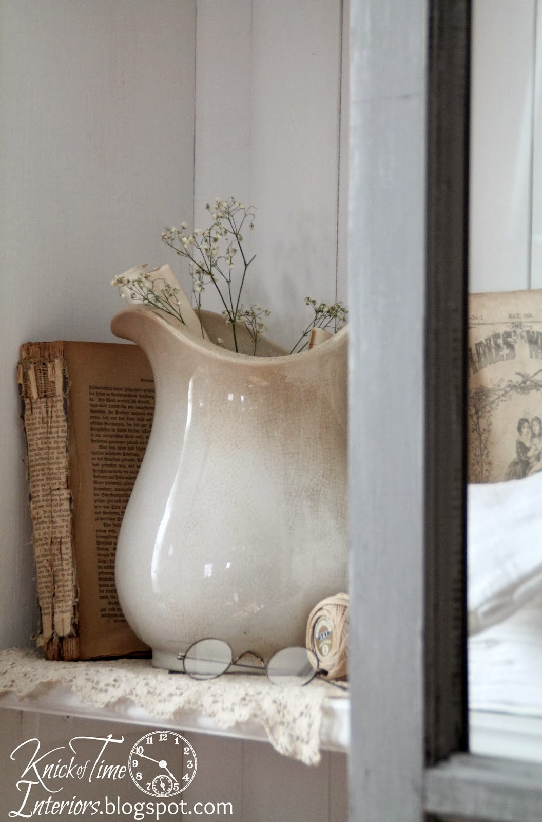Ironstone Pitcher and Antique Eyeglasses with Repurposed Windows into DIY Antique Cupboard Cabinet via Knick of Time
