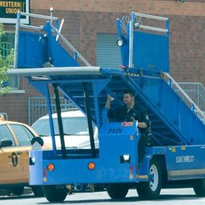 Did this airport worker drive to a pizza joint in his terminal stair car? [Photo: New York Post]