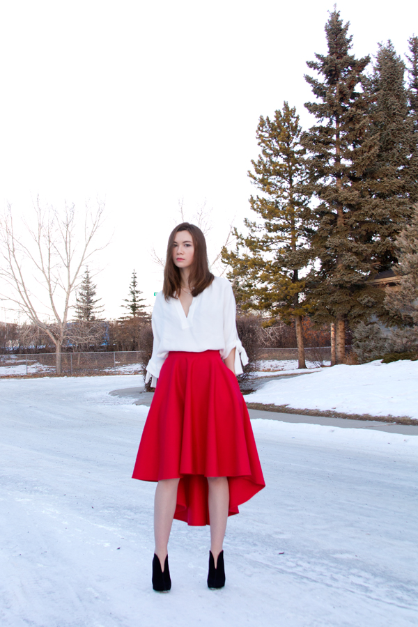 holiday outfit, holiday style, scuba skirt, christmas outfit, hi lo skirt, asymmetric skirt, nine west nero booties, bow blouse, bow sleeves