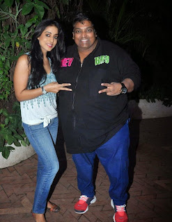 Mahie Gill looks slim and cute in Tight Denim Jeans Deep neck Tank Top at Holi Celebrations