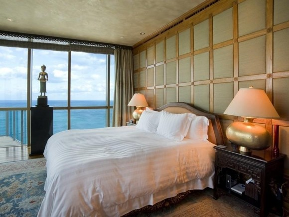 Photo of king sized bed in one of the bedrooms with the ocean view