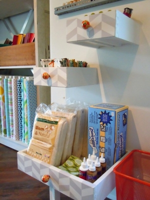 These hanging repurposed drawers make great storage for a craft corner.