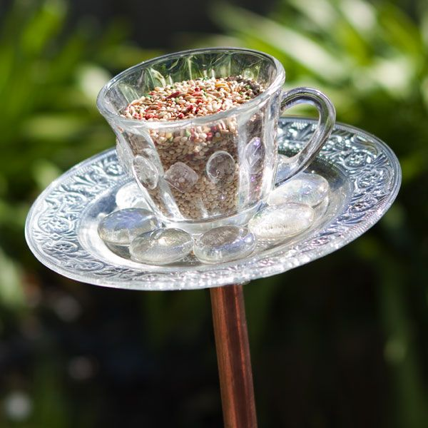 This simple teacup bird feeder uses the saucer as a place for the birds to land