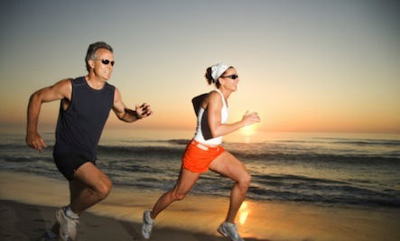 Relationship Reboot: Get Sweaty - man woman run running sport beach sea sand sunset