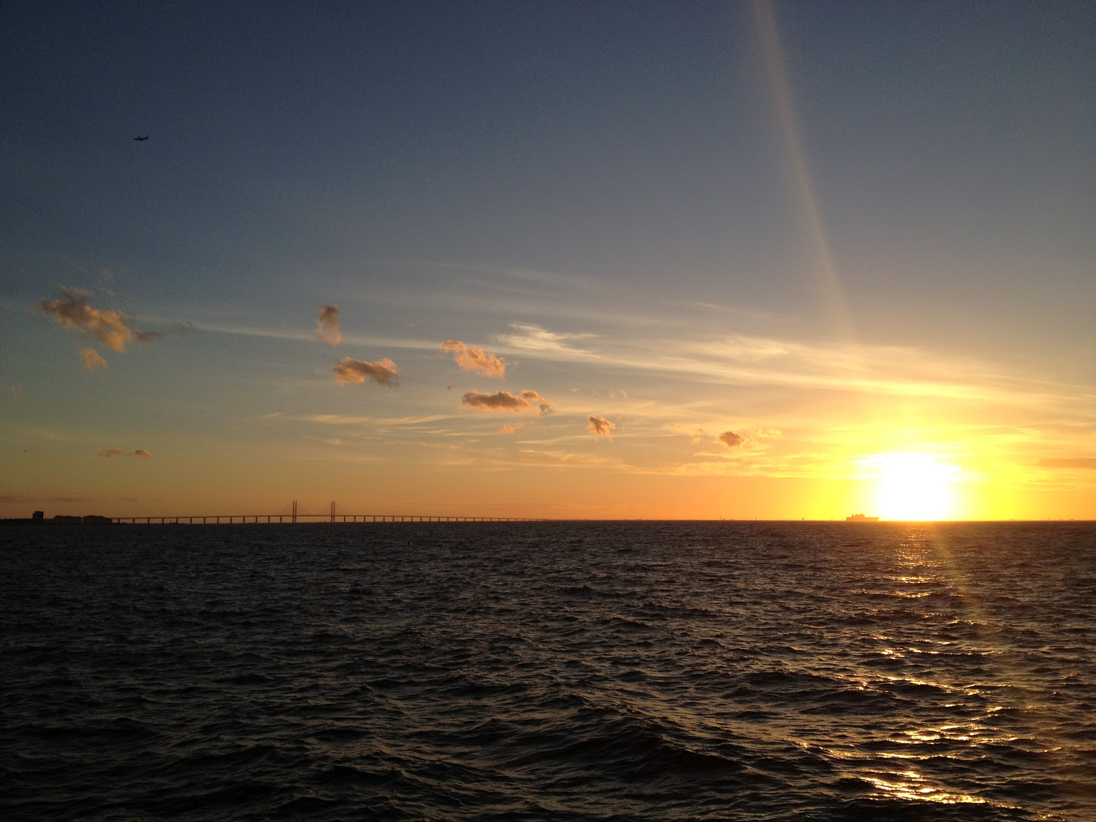 sunset in the Oresund Strait as seen from the western shore of Vastra Hamnen