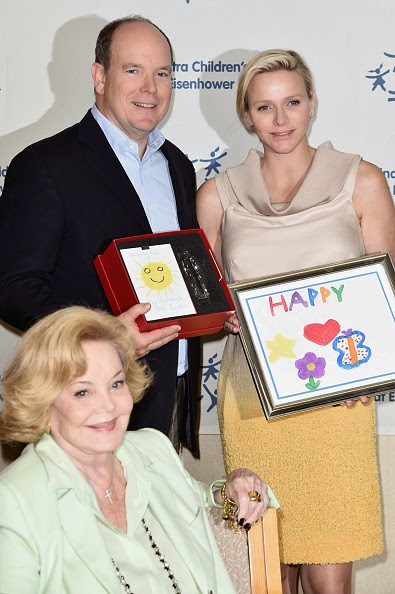 Prince Albert II of Monaco, Princess Charlene of Monaco and Barbara Sinatra (C) attend a visit to the Barbara Sinatra Children's Center