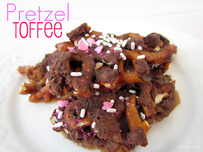 chocolate coated pretzel toffee on white plate with words