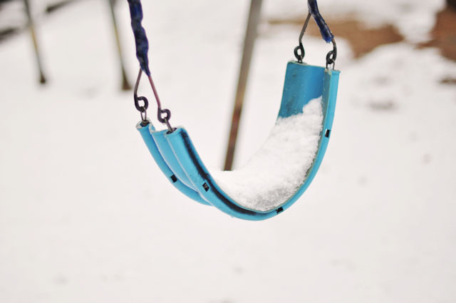 snow covered swing