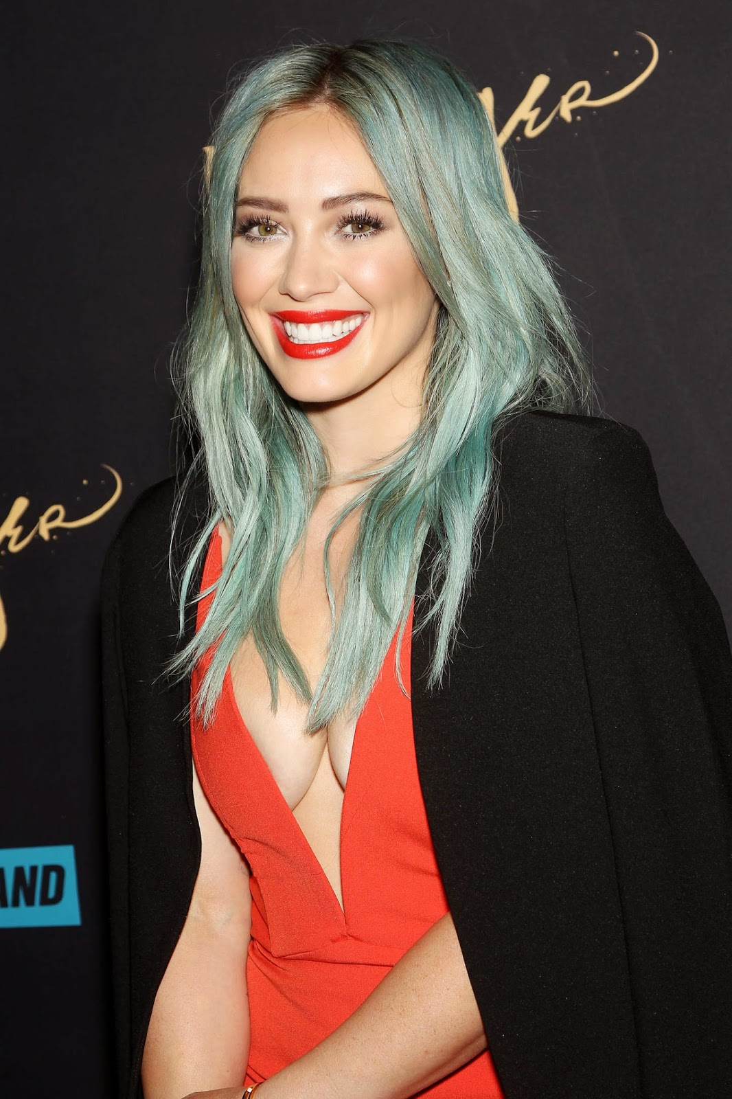 Hilary Duff bares cleavage in a low cut dress at the ... Hilary Duff