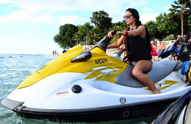 Tulisa enjoyed a drowsy sun while playing a jet ski in a white bikini on Monday, December 29, 2014.