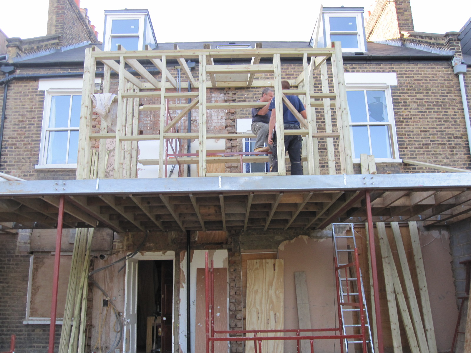 Down Below We Have The First Floor Extension Going Up, Timber Frame,  Covered With Insulation And Then Bricks On The Outside.
