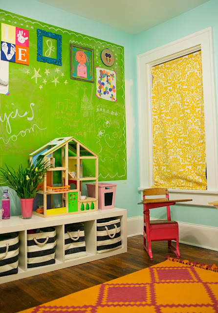 "Bright and fun, colorful little girl's room on a budget. Ikea Expedit bookcase, striped bins, vintage desk, bright rug, green chalkboard ""art"" wall."