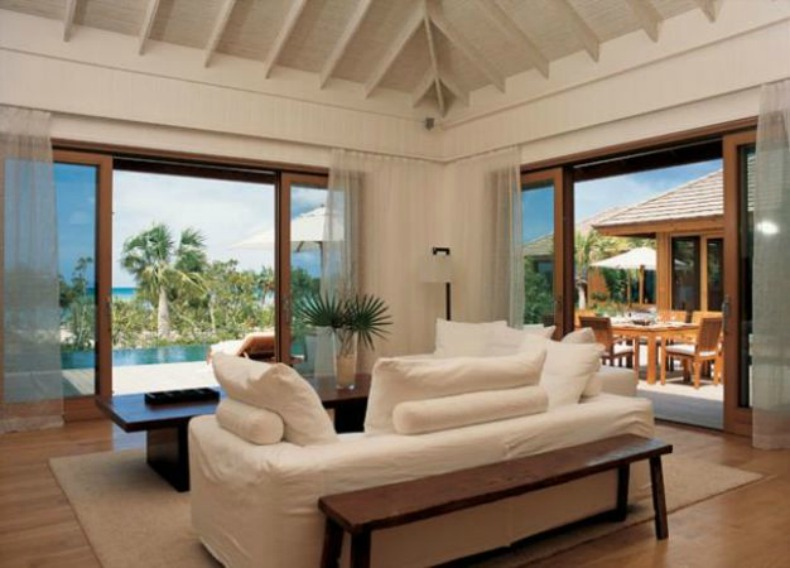 White slipcover sofas in coastal living room with ocean view
