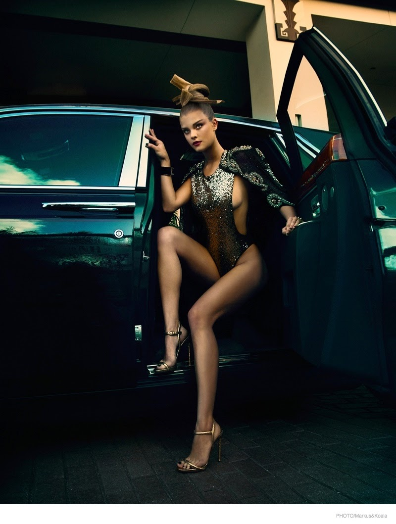 Nina Agdal models swimwear styles for Photo Magazine's December 2014 cover story