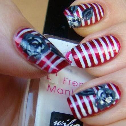 http://prettynailsbykasia.blogspot.com/2014/10/31dc2014-day-12-stripes-paseczki-z.html