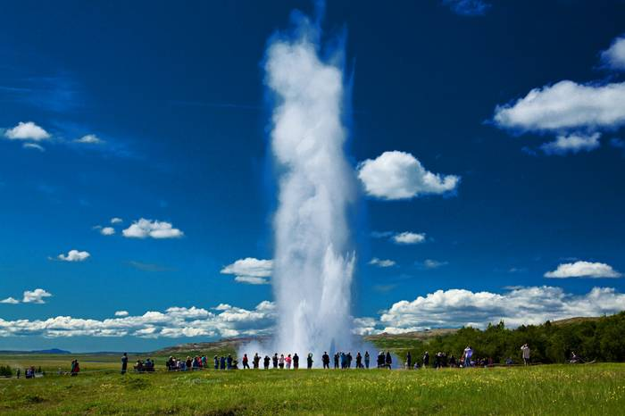 "Strokkur (Icelandic for ""churn"") is a fountain geyser in the geothermal area beside the Hvítá River in Iceland in the southwest part of the country, east of Reykjavík. It is one of Iceland's most famous geysers, erupting about every 4–8 minutes 15 – 20 m high, sometimes up to 40 m high."