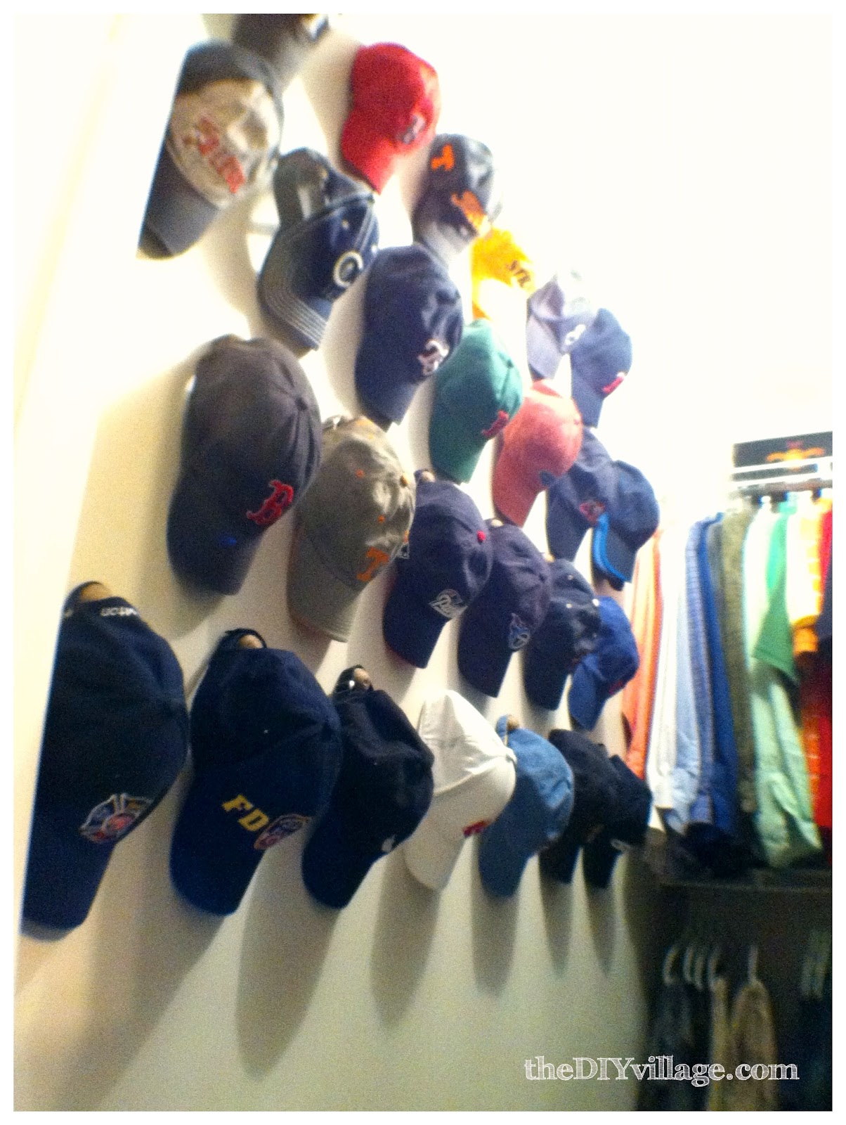 Matt 39 s closet makeover part two the diy village for Ways to hang hats on wall