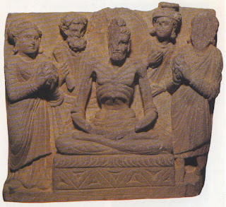 Buddha, having attempted for six years to attain enlightenment through the ascetic's route of starvation, realises that such means must be rejected just as firmly as the philosophical obscurities of the sages and the ritual of the priests, and accepts food from the daughters of Sena. Probably from Jamal Garhi, Yusufzai. British Museum, London.