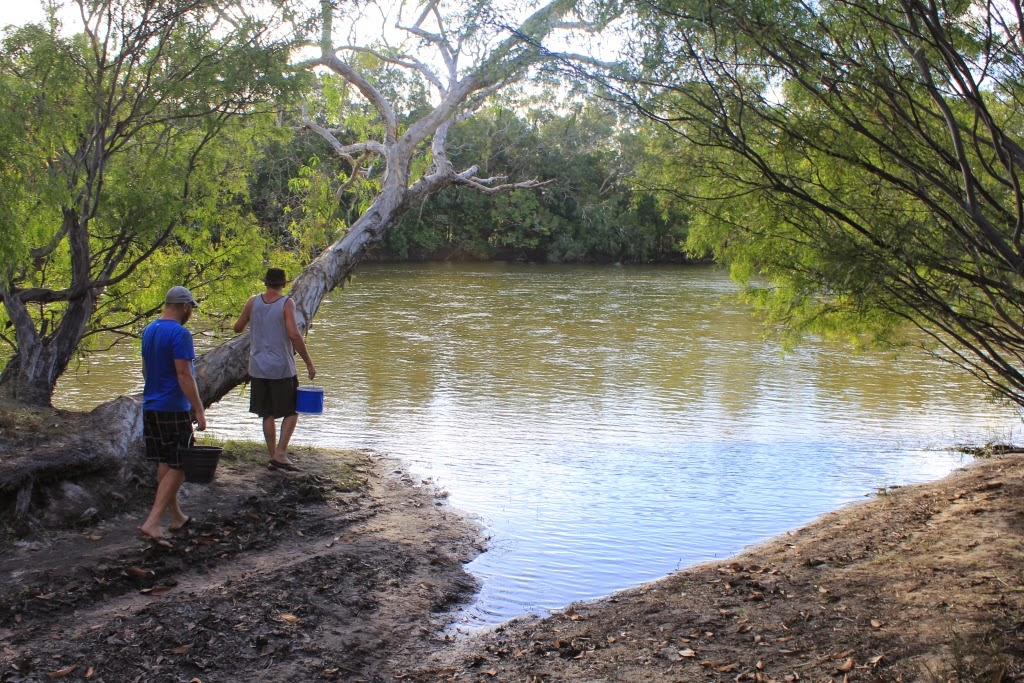 Colin & Christian - carefully getting water - there are CROCS in there !!