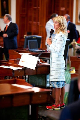 Texas State Senator Wendy Davis is currently in her 9th hour of a 13 hour filibuster needed to block a bill that would make abortion virtually unavailable to any Texas woman. Check out the sweet shoes.