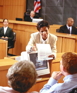 Female attorney presents evidence to the jury