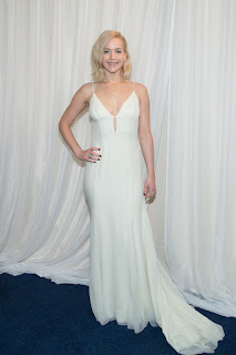Jennifer Lawrence in lovely white deep neck Gown at Premiere of JOY in New York