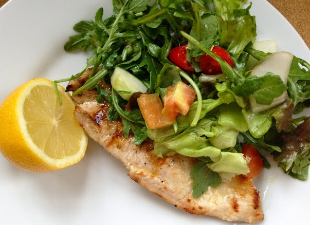 Drenched in a light lemony marinade, this grilled chicken is a crowd ...