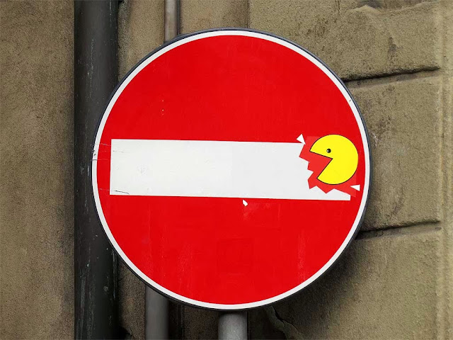 Clet Abraham, no-entry sign with Pacaman, piazza Santa Croce / via Torta, Florence