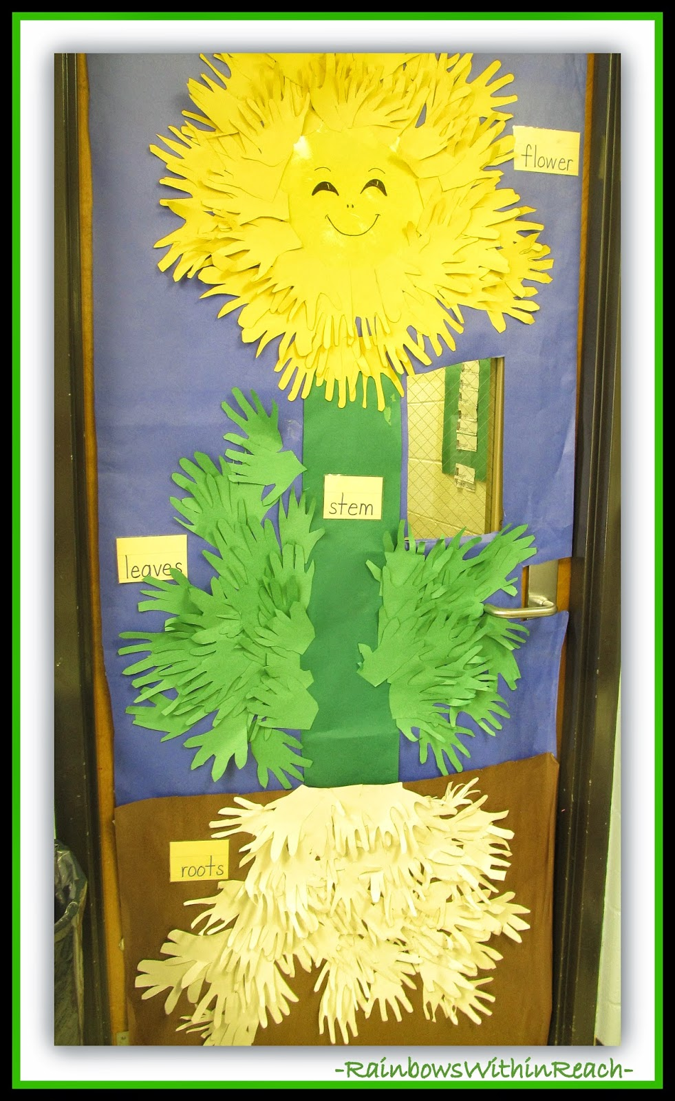 Classroom Door Decorated with Hands Creating a Flower with Roots at RainbowsWithinReach