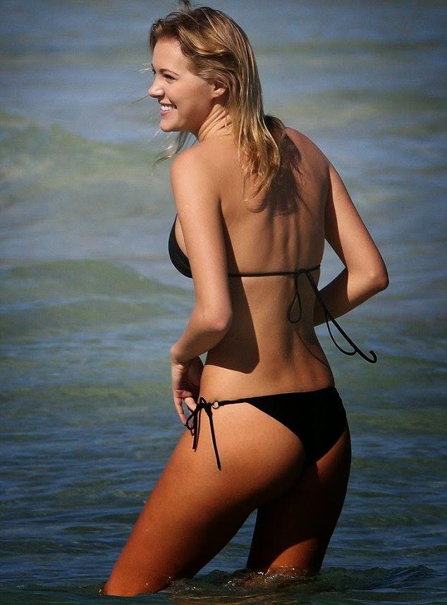 Deimante Guobyte slips into a Black Bikini for a dip in the Miami sea on Wednesday, April 2, 2014