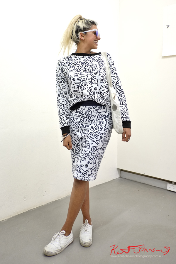 Keith Haring print dress, or skirt and top, plimsolls, yin/yang necklace. Street Fashion Sydney by Kent Johnson.