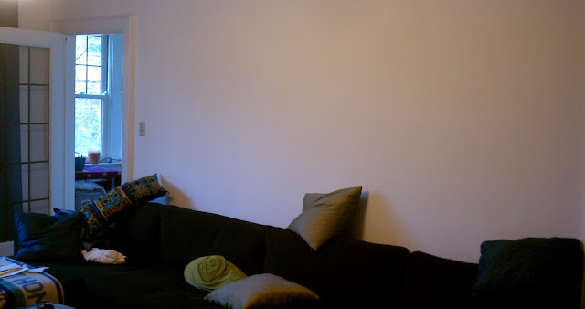 IKEA Karlstad sofa with blank wall behind it