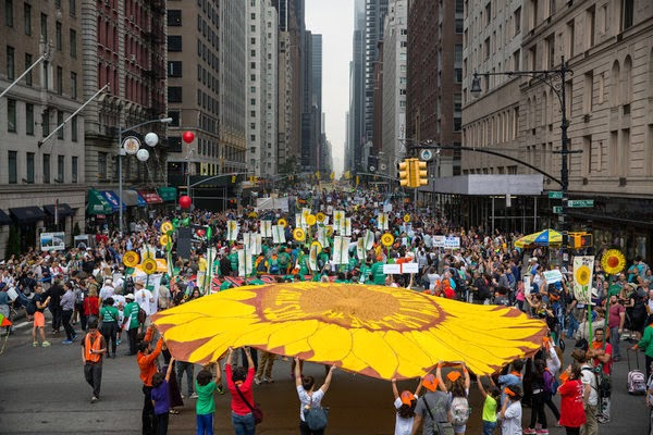 Before the People's Climate March on Sept. 21, Mayor Bill de Blasio announced his ambition to cut greenhouse gases in New York. (Credit: Damon Winter/The New York Times) Click to Enlarge.