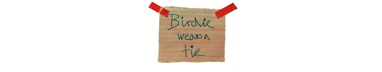 Birdie wears a tie