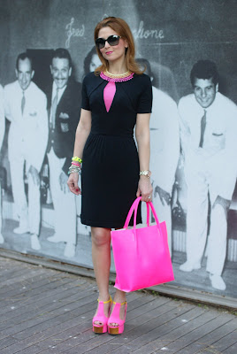 Neon bag, neon shoes, black dress