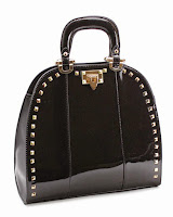 http://shoptheshoppingbag.com/collections/new/products/studded-glossy-structure-bag