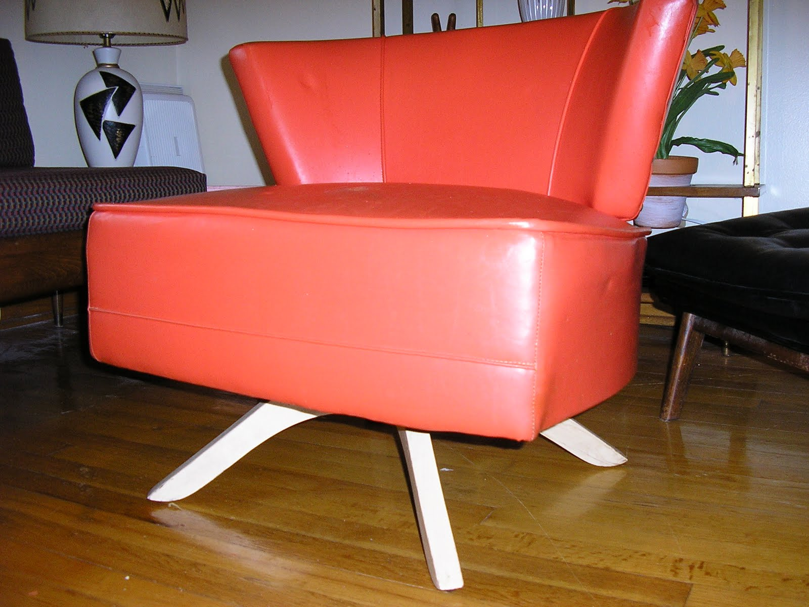 Bright Retro Orange Vinyl Swivel Chair With 50u0027s Blonde Legs. One Repair In  Seat The Size Of A Nickle But No Other Problems With This Bueatiful Chair.