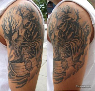 Grim Reaper tattoo on the shoulder and arm