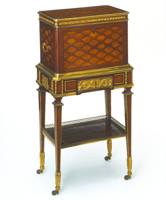 Žans Anrī Rizeners Jewel casket on a stand, veneered with mahogany, sycamore, and purplewood, by Jean-Henri Riesener, c. 1780; in the Victoria and Albert Museum, London.