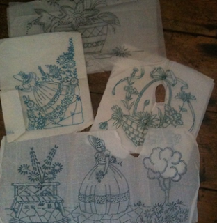 A stack of vintage embroidery transfers