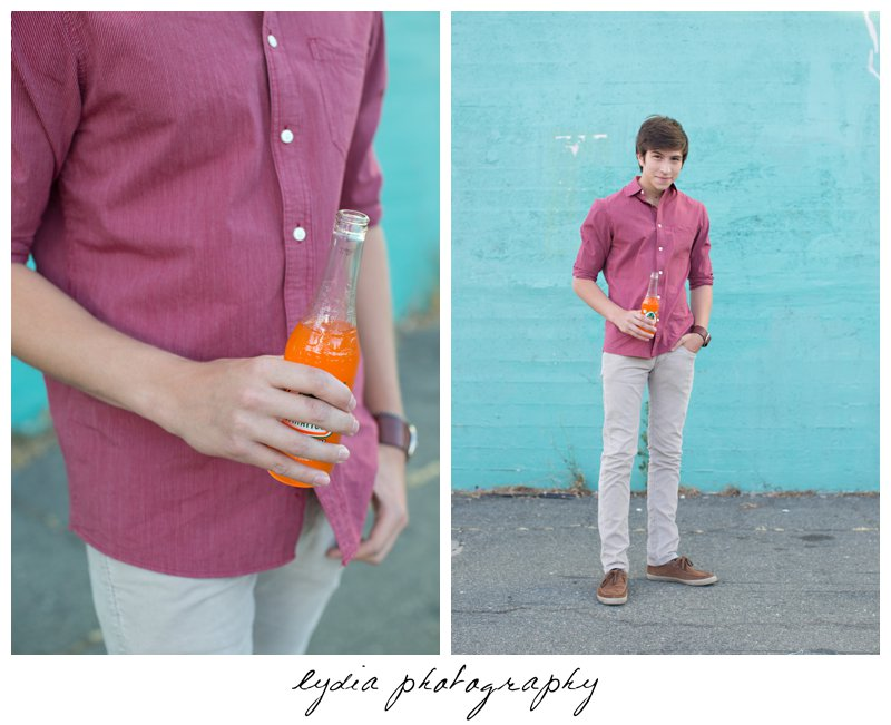 Senior guy with an orange drink at Forest Lake Christian senior lifestyle portraits in Rocklin, California
