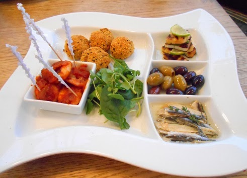 Saffron arancini, fresh anchovies, olives and grilled halloumi ...